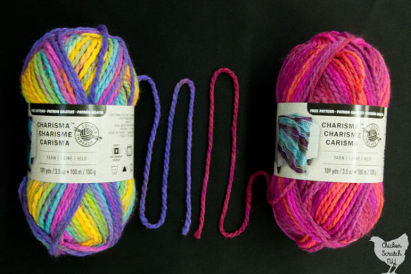 two balls of charisma yarn in the colors Bright Pop and Passion