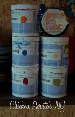 six sample jars of paint for a plywood barn Quilt