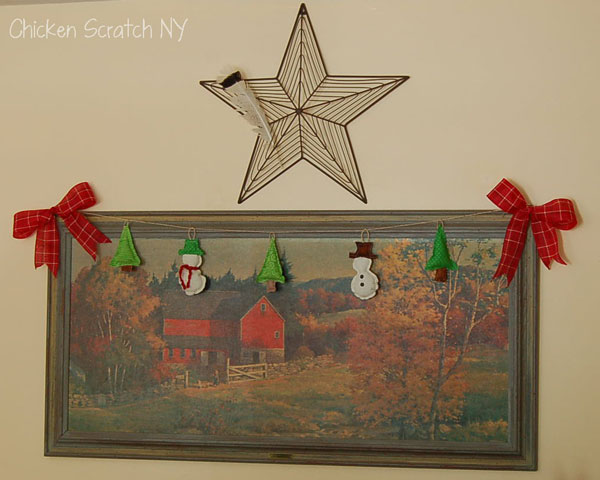 christmas ornaments hung on painting