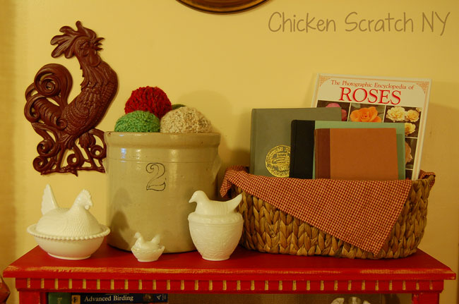 barn red bookcase, crock and milkglass chickens