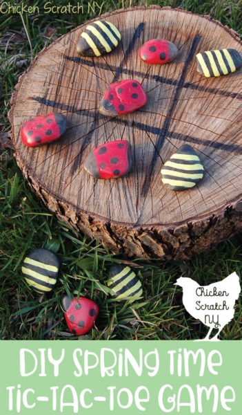 wood stump with painted tic tac toe board with sontes painted like ladybugs and bumble bees for game pieces