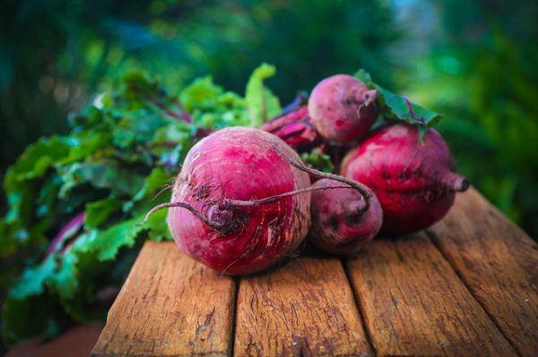 red beets on a wooden surface