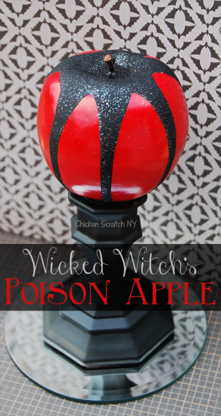 fake apple spray painted and covered in glitter to make a DIY Halloween Witch's Poison Apple