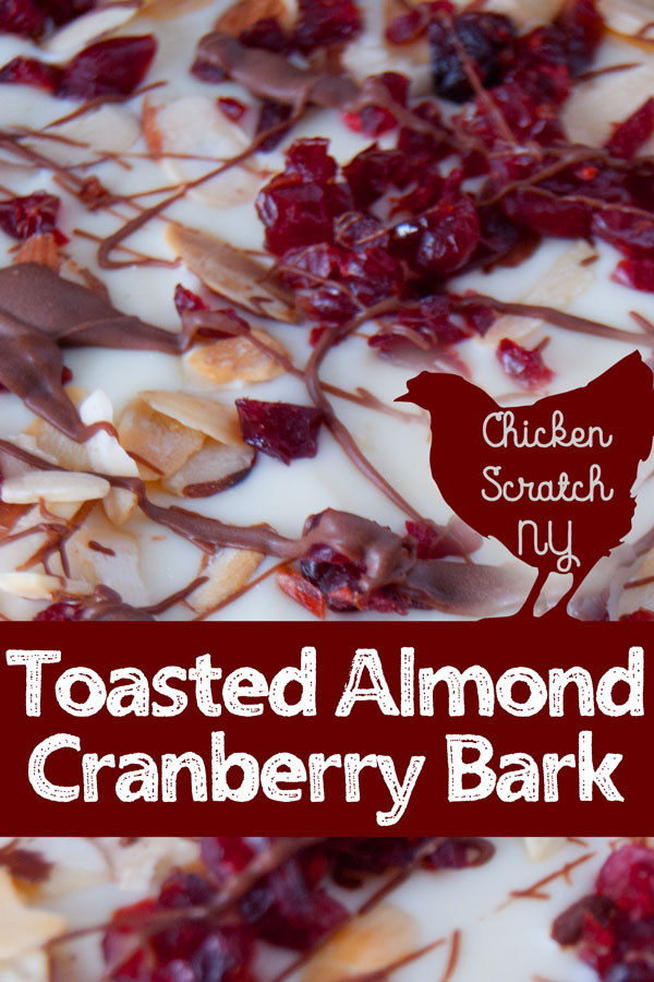Toasted Almond and Cranberry bark is a delicious and quick holiday treat that doesn't require the oven, you'll fall in love with the crunchy almonds and sweet-tart cranberries nestled into creamy chocolate #Christmascookies #Almondbark
