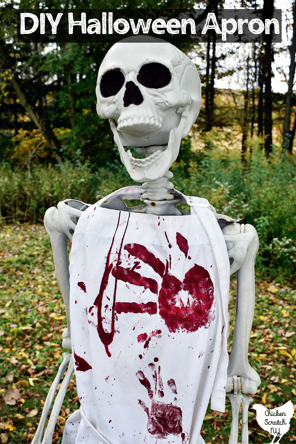 life sized Halloween skeleton wearing a white Bloody Halloween Apron
