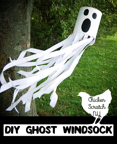 Turn an empty can into a glowing phantom with this DIY tutorial for a ghost windsock with ribbon and paint for a spooky friend straight from the recycle bin