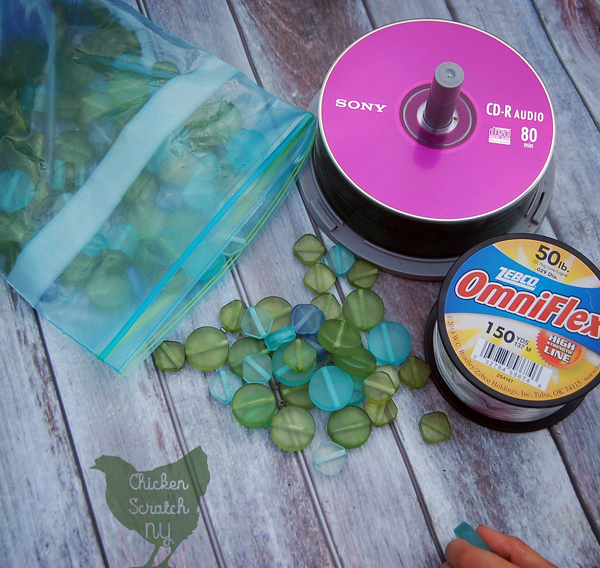 Use up old CDs with this fun rainy day craft project. Easy enough for a three year old and pretty enough to decorate any garden