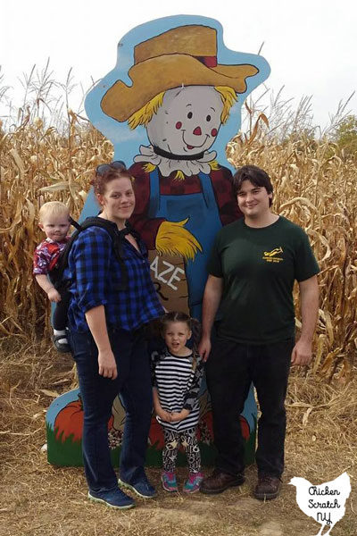 happy family at a corn maze
