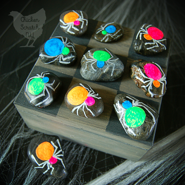 Entertain your favorite little goblins with a game of Halloween tic-tac-toe! Paint a game board on a wooden box to double as a carrying case
