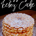 vanilla pizzelle cookies with eggnogg pudding pilling stackes and dusted with powdered sugar on a wooden surface