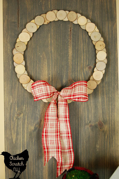 Decorate with a DIY rustic snowman and wood slice wreath for a simple display to carry you from Christmas though the winter season