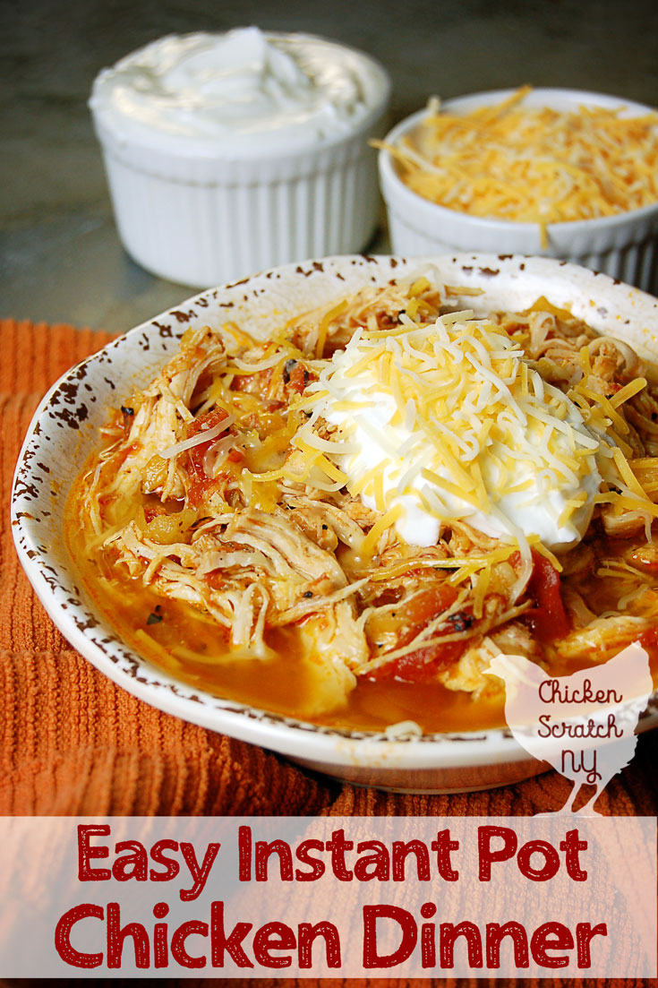 white bowl filled with instant pot chicken dinner with tomatoes and pineapple on an orange towel with two small white bowls filled with shredded cheese and greek yogurt