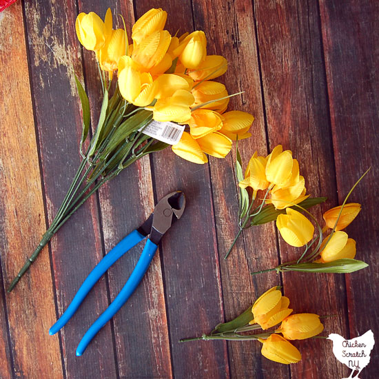 yellow tulips cut into pieces with wire cutters