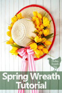 sun hat turned into a apring wreath with yellow tulips and pink striped ribbon