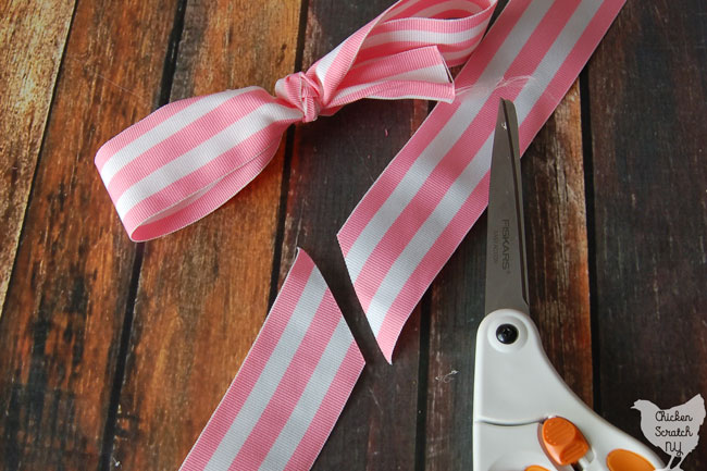 striped ribbon tied into bow