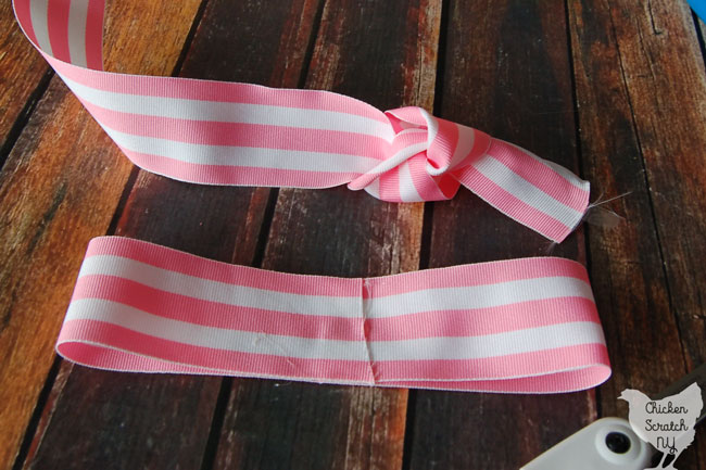 striped ribbon tied onto a bow