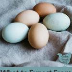 tan and blue fresh eggs on a cloth