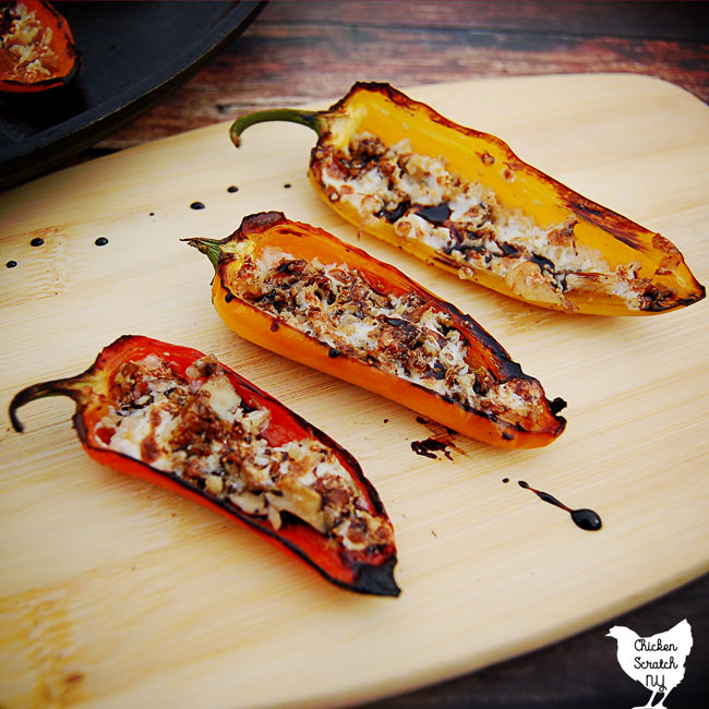 red, orange and yellow pepper filled with chicken and melted mozzarella cheese