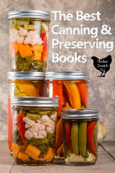 stacked jars of canned produce with text overlay for The Best Canning & Preserving Books