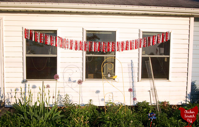 4th of July no sew americana garland from bandanas hanging in a flower garden