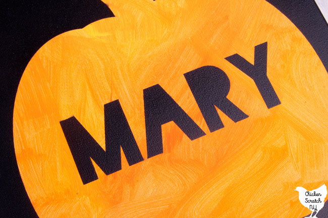 pumpkn painted on a canvas with the name Mary painted in black