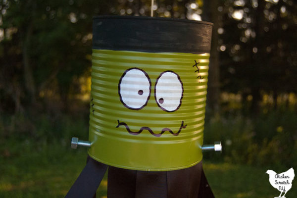 tin can turned into DIY Frankenstein Windsock with paint, screws and ribbon