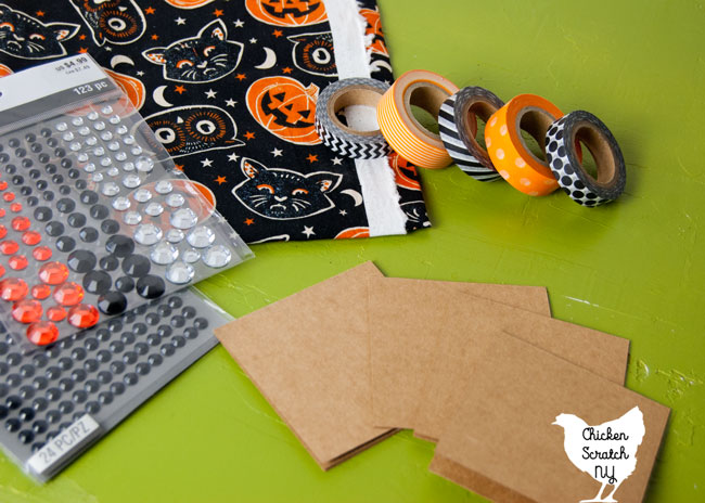 halloween banner supplies: halloween fabric, washi tape, not cards and self adhesive rhinestones