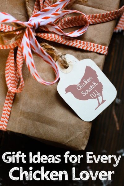 gift box wrapped in kraft paper with red and white ribbons and a white tag with a red chicken against a black background with text overlay Gift Ideas for Every Chicken Lover