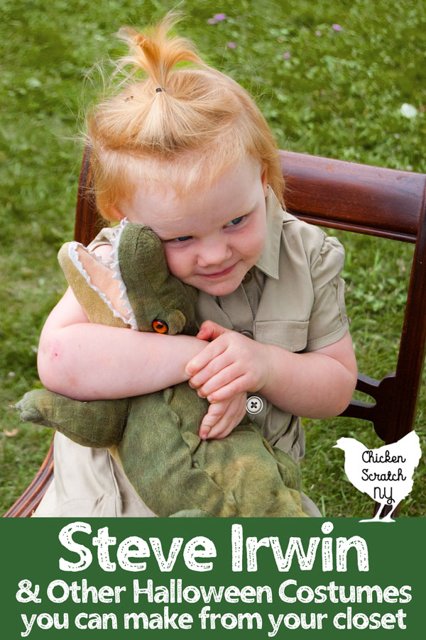 young blonde girl in a khaki saffri shirt hugging a stuffed crocodile for a Steve Irwin Halloween Costume