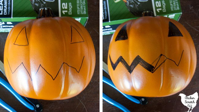 sharpie face on fake pumpkin