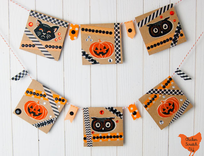 six card Halloween banner with vintage pumpkin, cat and owl faces with orange and black washi tape cross crossed around the Halloween shapes and orange, black and clear rhinestones