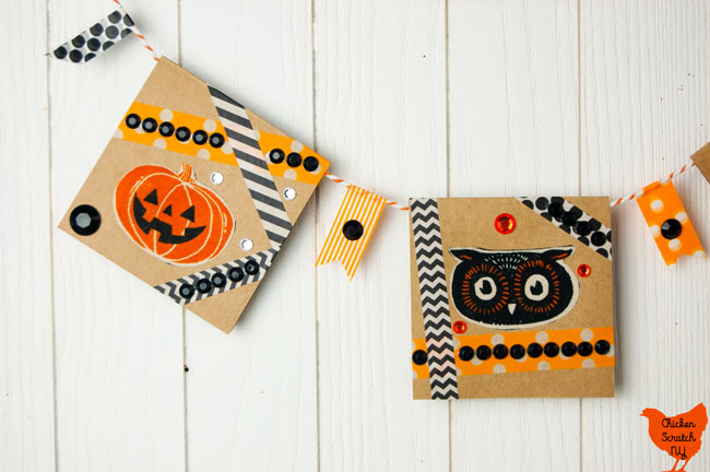 close up of Halloween banner card with owl face, jack o lantern, orange and black washi tape and rhinestones