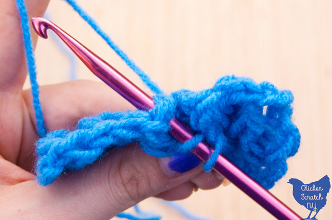 working around the back post in a blue super saver yarn