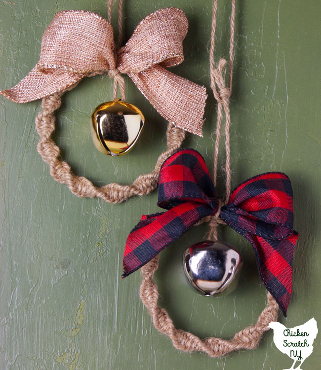 two macrame wreath ornaments made with twine, jingle bells and metallic burlap ribbon or buffalo check ribbon