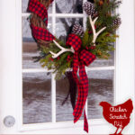 rustic farmhouse country wreath made with buffalo check ribbon, pine cones, antlers and faux greenery