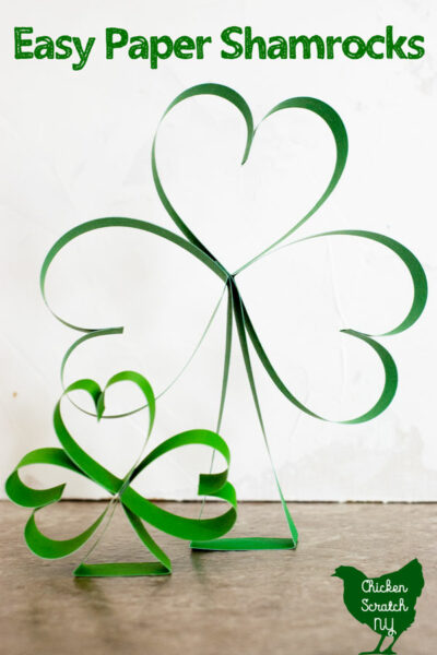 two sizes of paper shamrocks