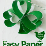 paper shamrock hanging from green and white striped twine