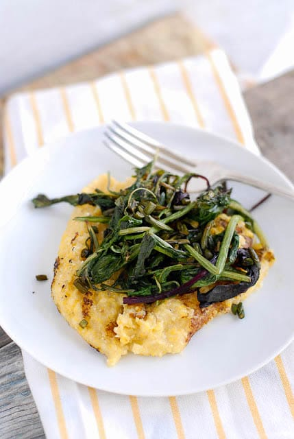 Pan Browned Polenta with Sauteed Braising Greens and Garlic Scapes