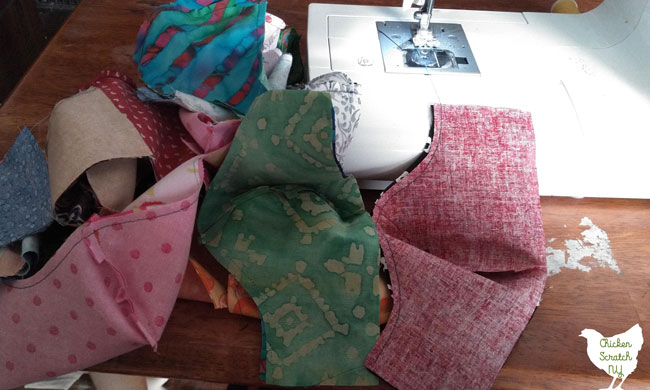 group of face masks sewn together out of quilter cotton with a home sewing machine