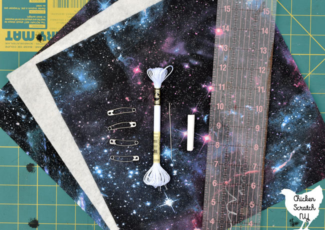 supplies for halloween spider mini quilt, galaxy fabric, batting, embroidery thread, needle, ruler, chalk