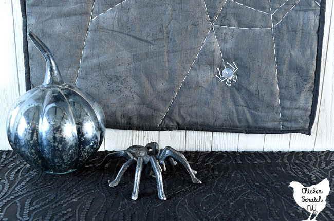 spiderweb table runner with mercury glass pumpkin and cast iron spider