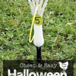 skeleton hand with glowstick necklace and tag for five points with text overlay Cheap & Easy Halloween Party Games