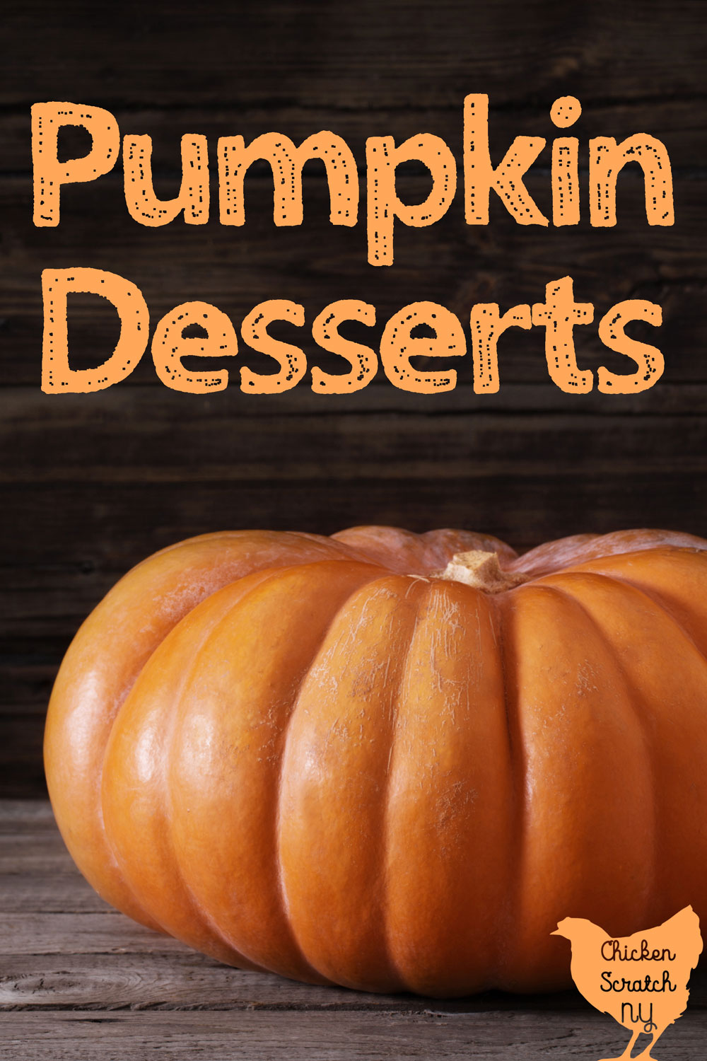 pumpkin sitting on a wooden table with text overlay Pumpkin Desserts