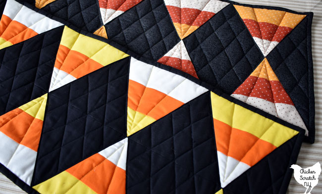 60 degree quilting ruler candy corn table runners in bright solids and muted autumn prints