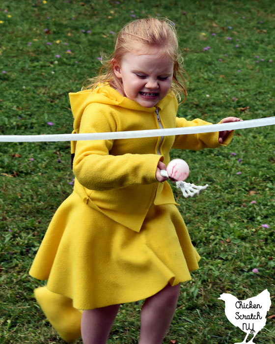 little girl in Pikachu costume playing eyeball on a spoon race Halloween Party Game
