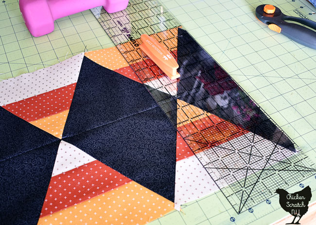 trim table runner to a rectangle with a long ruler