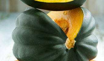 sliced green acorn squash with text overlay acorn squash recipes