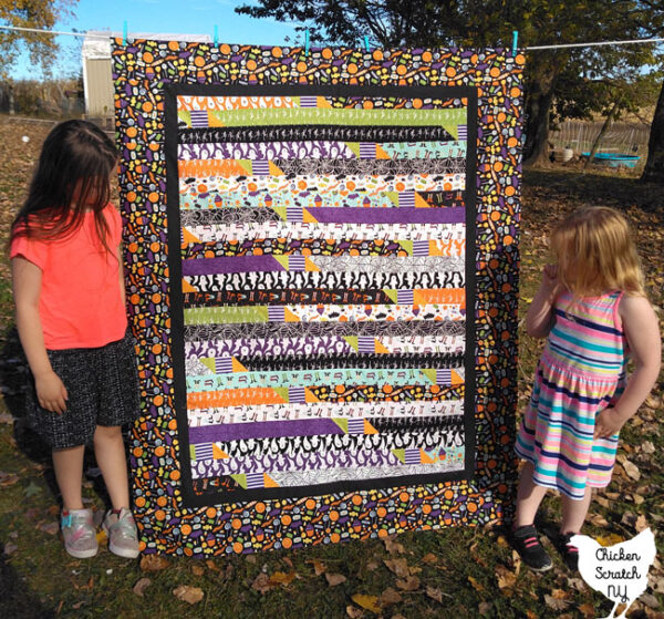 Halloween jelly roll race quilt using Hocus Pocus fabric