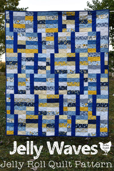 yellow and blue Jelly Waves quilt made with 2 1/2 inch strips hanging on a clothes line