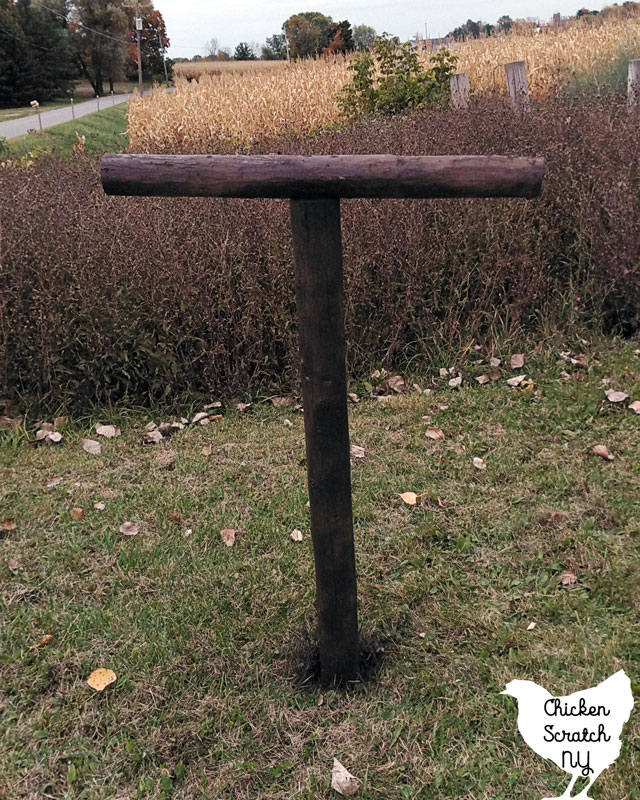 brown fence post scarecrow body